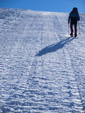 The man in snowshoes in the mountains. Royalty Free Stock Photos