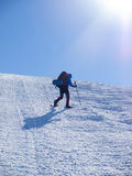 The man in snowshoes in the mountains. Stock Photos