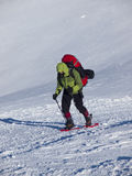 The man in snowshoes in the mountains. Royalty Free Stock Images