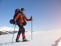 A man in snowshoes is the snow. Stock Image
