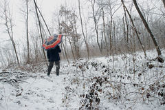 Man in snowy forest Stock Photo