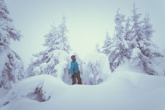 Man in snowy forest Stock Images