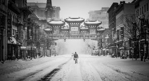 Man on snowy streets of Chinatown Royalty Free Stock Photos