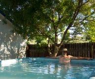 A man soaking in healing waters at pagosa springs Royalty Free Stock Photography