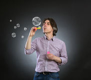 A man and soap bubbles. Royalty Free Stock Images