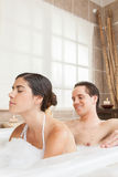 Man soaping his wife. In the tub stock photos