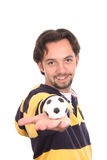 Man with a soccer ball balanced on finger Royalty Free Stock Images