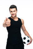 Man with soccer ball showing thumb up sign Royalty Free Stock Photo