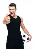 Man with soccer ball showing thumb up sign Royalty Free Stock Photography