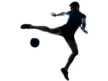 Man soccer football player flying kicking Royalty Free Stock Images
