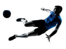 Man soccer football player flying kicking Royalty Free Stock Image