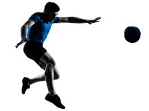 Man soccer football player flying kicking. One caucasian man flying kicking playing soccer football player silhouette  in studio isolated on white background Stock Photography