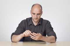 Man on social media. Via app on smart phone Royalty Free Stock Image