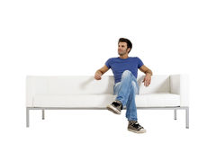 Man on the sofa. Man sat on the sofa Royalty Free Stock Photo