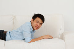 Man on Sofa Royalty Free Stock Photography