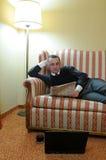 Man on sofa royalty free stock photos