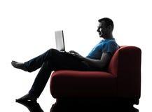 Man sofa coach computer computing laptop Stock Photos