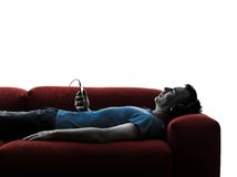 Man sofa coach listening music audio Royalty Free Stock Photo