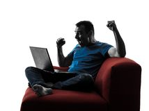 Man sofa couch computer computing laptop Royalty Free Stock Image