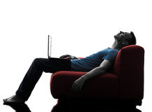 Man sofa couch computer computing laptop Stock Photography