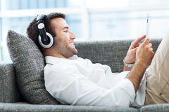 Man on sofa Royalty Free Stock Images