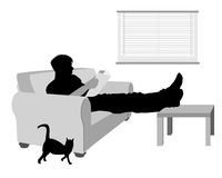 Man on a sofa reading something Stock Image