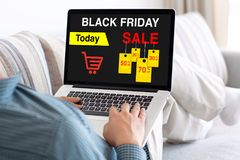Man typing laptop keyboard with sale black friday on screen Royalty Free Stock Image