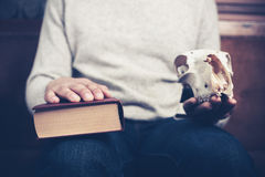 Man on sofa with skull and book Stock Photo