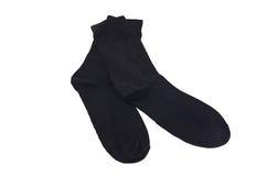 Man sokken op witte achtergrond worden geïsoleerd die stock foto's