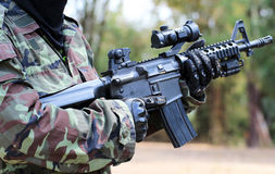 A man in soldier suit with bb gun. And blur background Stock Photography