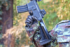 A man in soldier suit with bb gun. And blur background Stock Photos