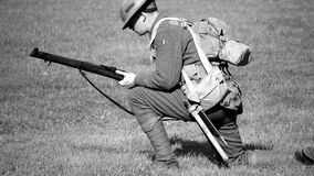 Man in Soldier Suit Holding Gun Knees Down in the Ground Stock Photos