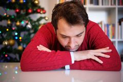 Man in solitude feeling bad during christmas day Stock Photo