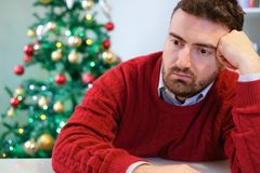 Man in solitude feeling bad during christmas day Stock Photos