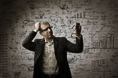 Man solving maths problems Stock Images