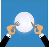 Man som äter med gaffeln och kniven Royaltyfria Bilder