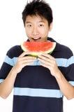 Man som äter melonen Royaltyfria Bilder