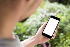 Man som använder den mobila smartphonen Arkivfoton