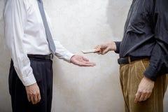 Man som betalar en Hryvnia muta till en Corupted Nan Accepting It Fotografering för Bildbyråer