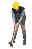 Man som försöker att lyfta sledgen-hammer Royaltyfria Bilder