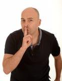 Man som gör en gest för tystnad Arkivfoton