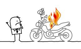 Man som håller ögonen på en brinnande moped Fotografering för Bildbyråer