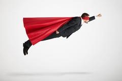 Man som kläs som en superhero arkivbild