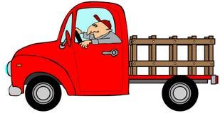 Man som kör en röd insats-sida lastbil Royaltyfri Fotografi