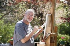 man som målar utomhus Royaltyfri Fotografi