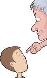 Man som pekar på barnet Arkivbild