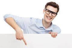 Man som pekar på den tomma affischen Fotografering för Bildbyråer