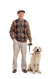 Man som poserar samman med hans hund Royaltyfria Bilder