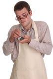 man som reparerar kompetent watchbarn Arkivfoto