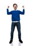 Man som ropar med händer som lyfts upp Fotografering för Bildbyråer